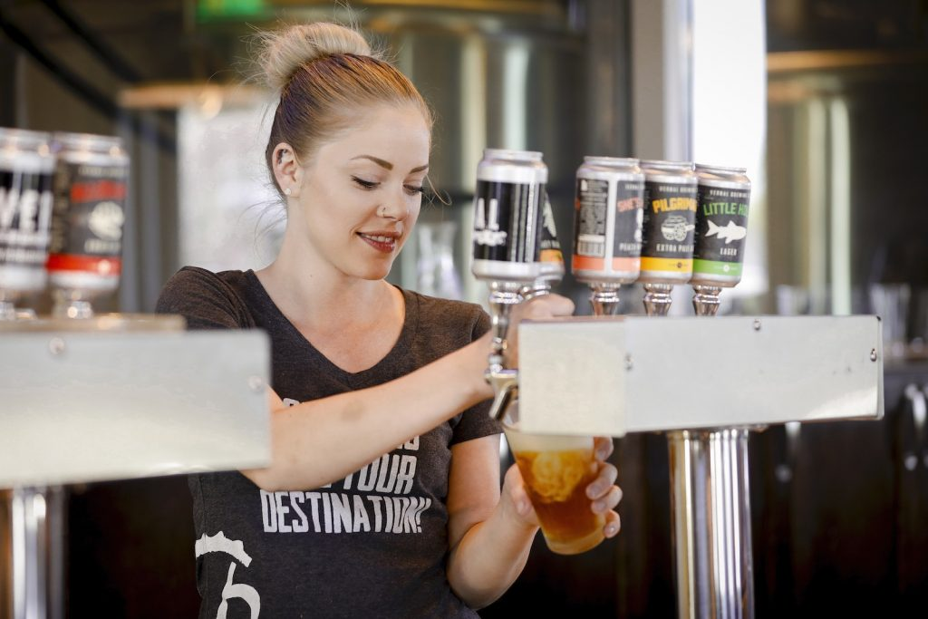 Bartender pouring Vernal Brewing beers in Dinosaurland, Utah