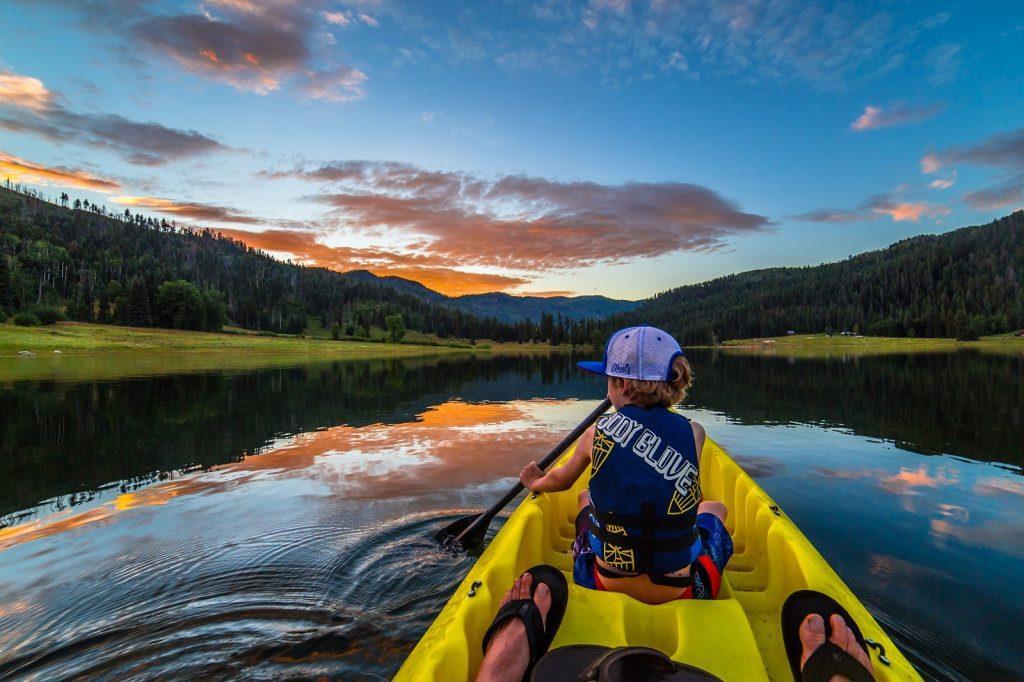 kid kayaking on water What to do in Durango Colorado Visit USA Parks