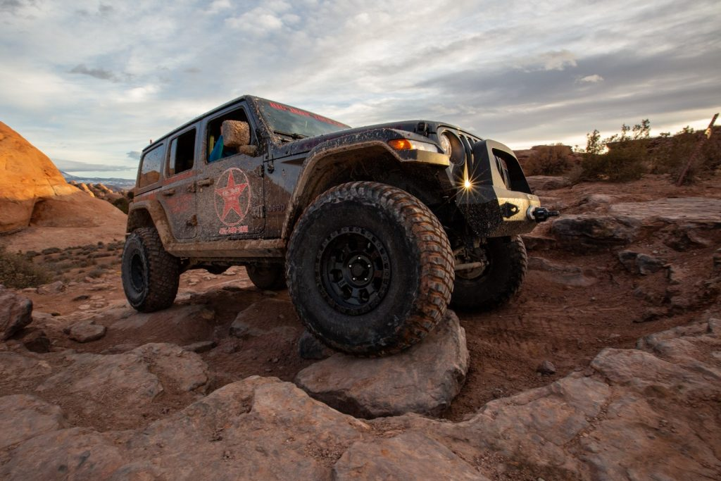 Jeep crawling over rocks in Moab