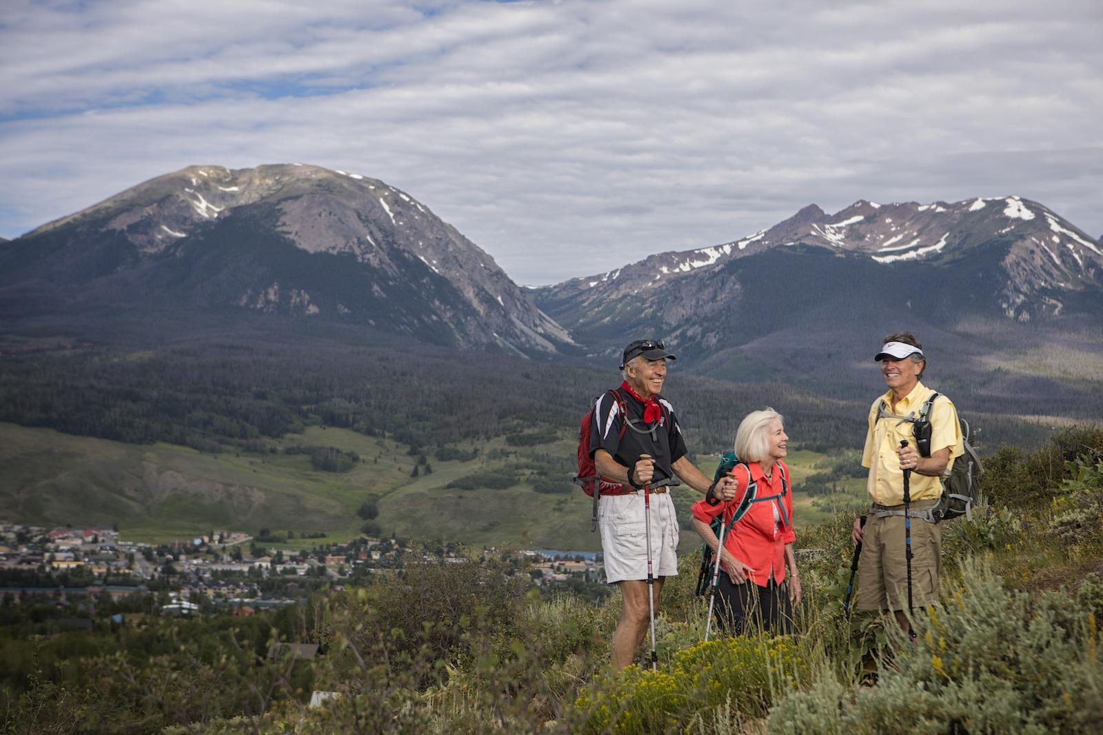 Three people hiking in Dillon and Silverthorne area of Colorado