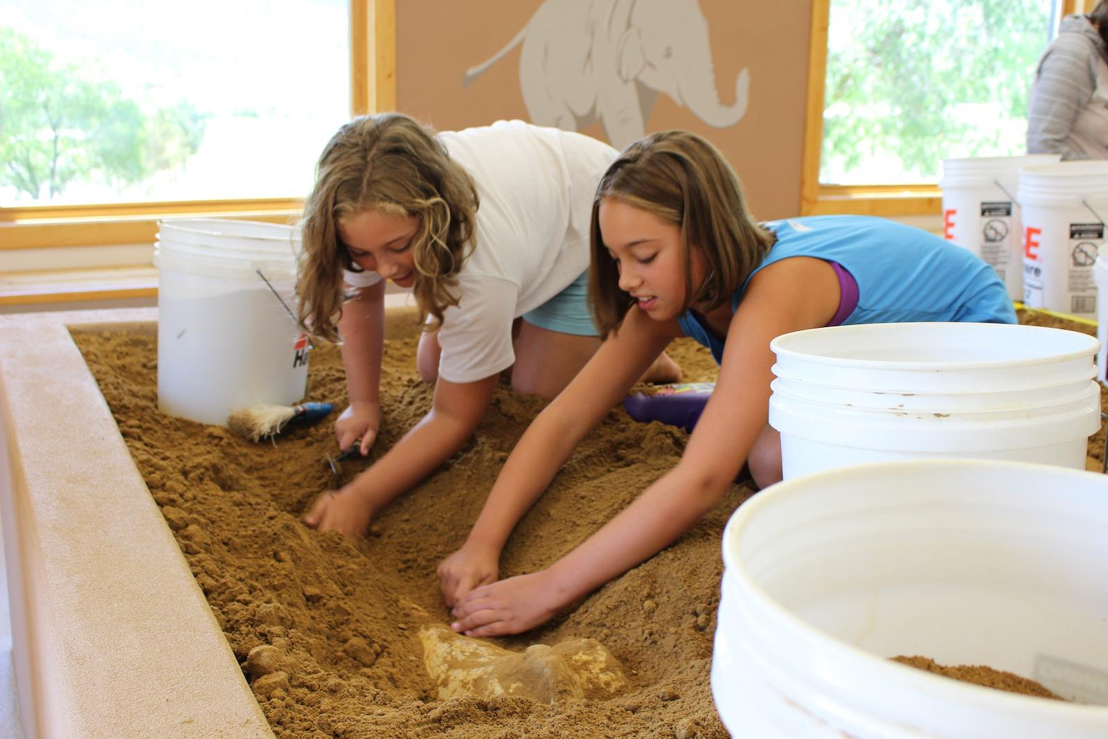 two kids dig up fossils in Hot Springs, South Dakota
