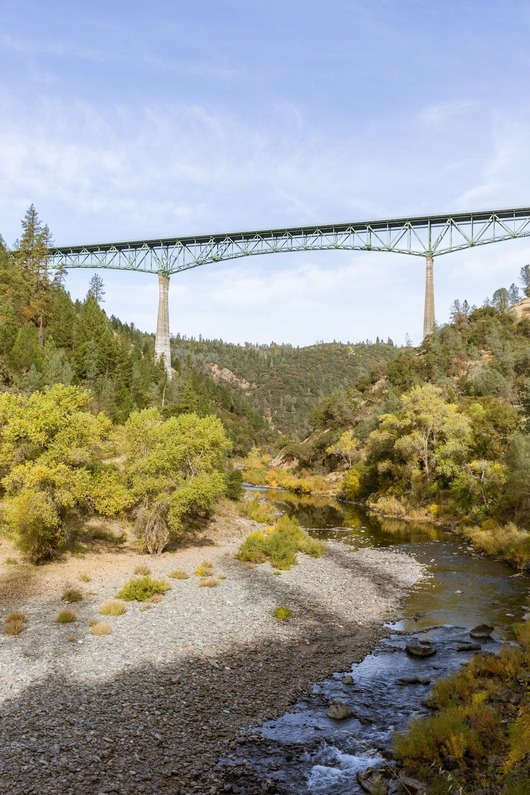 Bridge over a trail and river in California's Gold Country