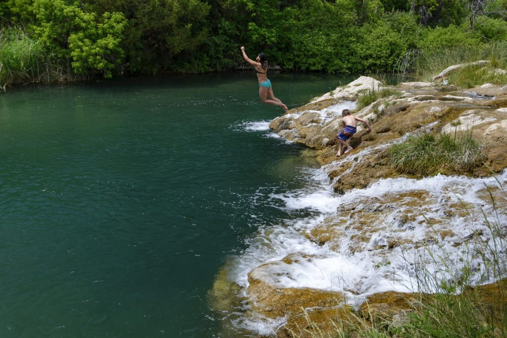jumping into the water at Cascade Falls