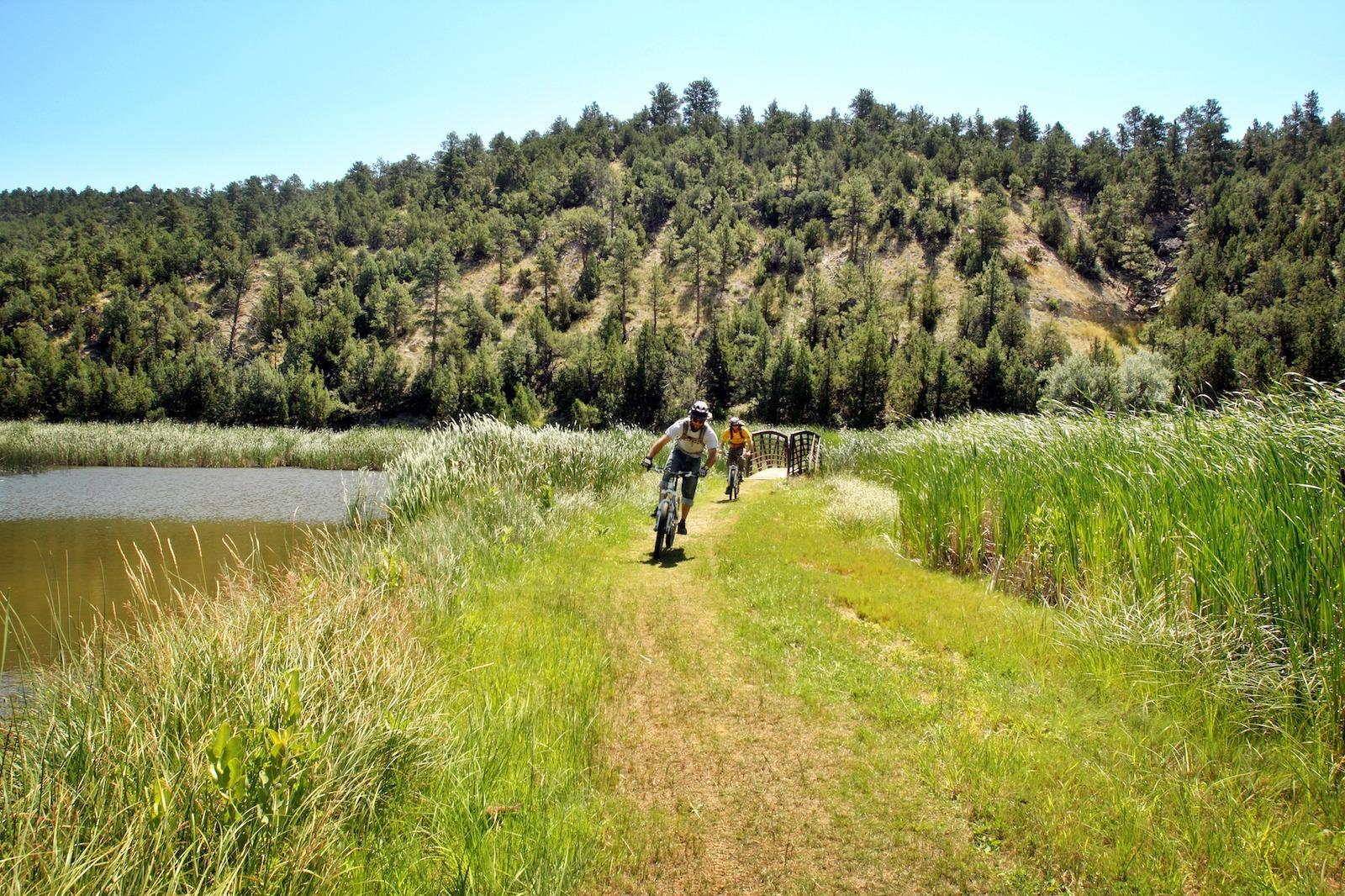Two mountain bikers on family vacation on an easy trail along Glendo State Park in Platte County, Wyoming