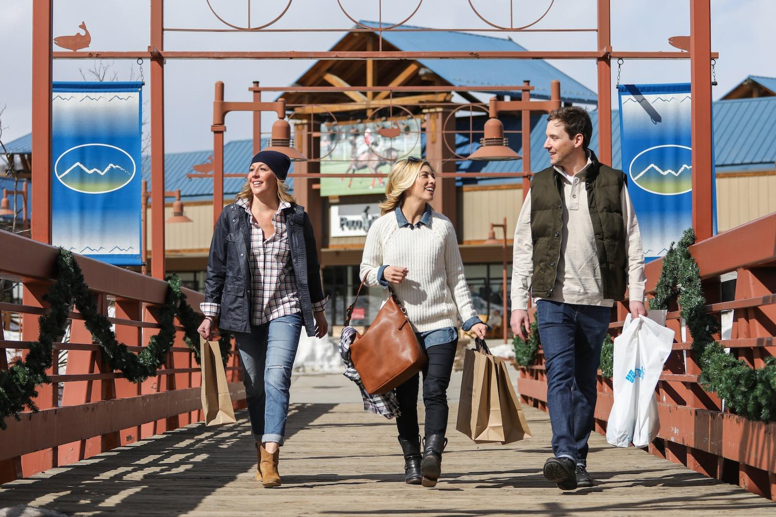two women and one man shopping in the Outlets at Silverthorne, CO
