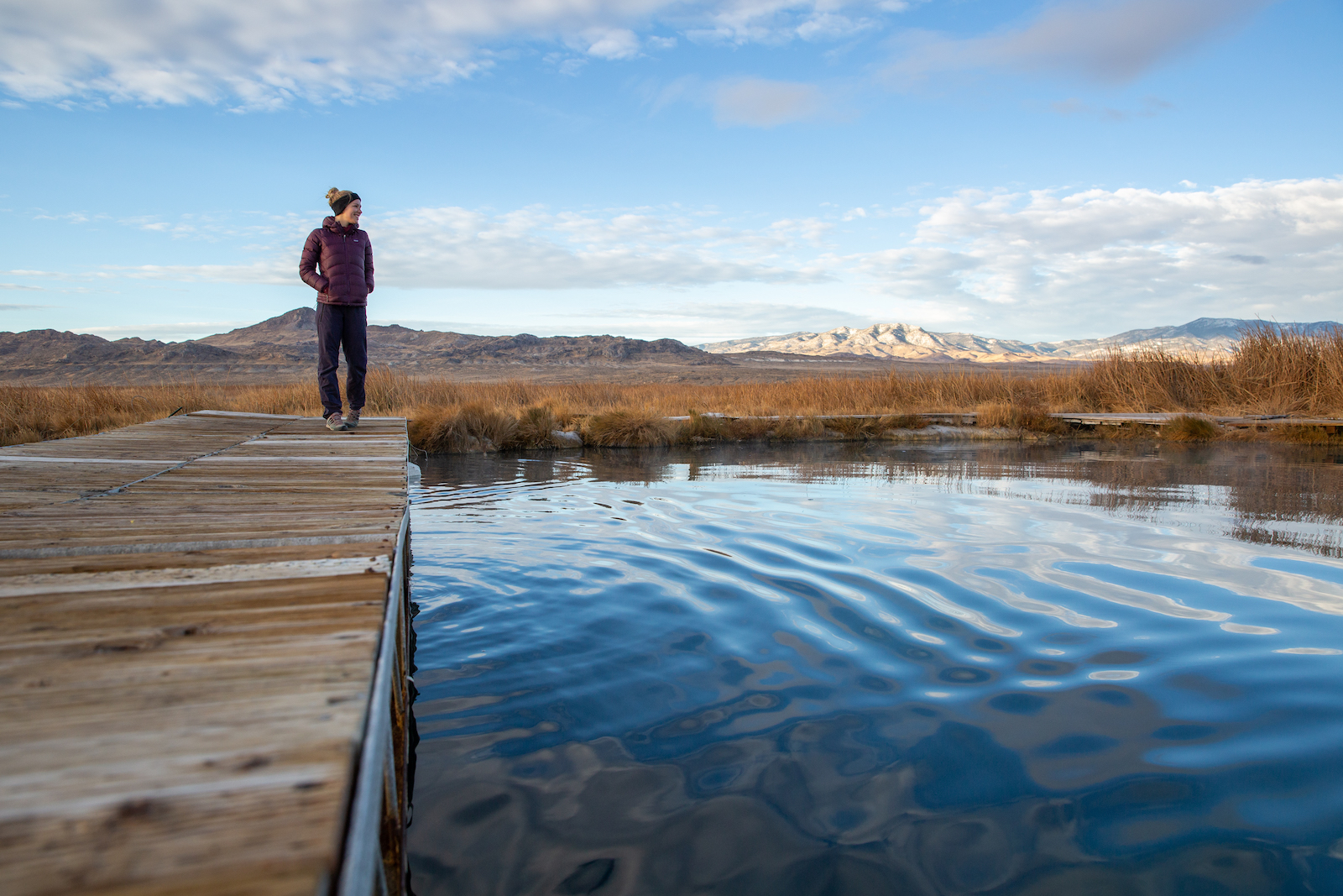 Woman at edge of Blue Lake in Cowboy Country, Nevada