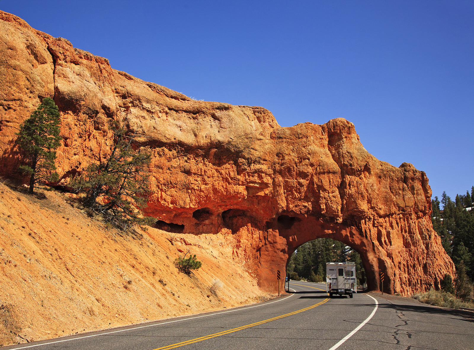 Truck with camper on Highway 12 Scenic Bypass in Utah
