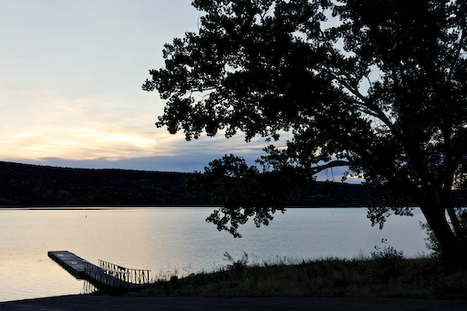 Sunset with tree and pier at Lyman Lake State Park in Arizona