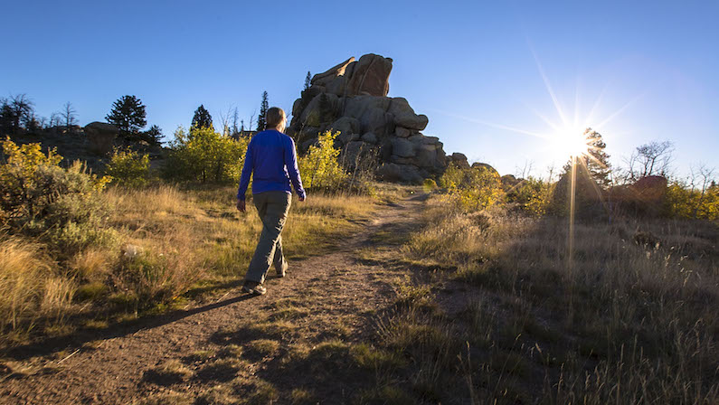 Woman on hiking trail in Laramie in the summer at Vedauwoo