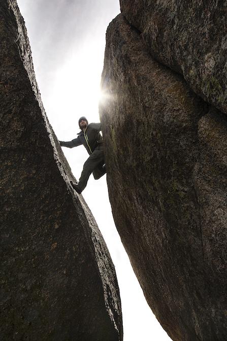 man crack climbing in Laramie in the summer