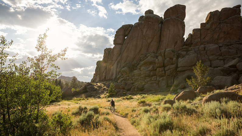 Mountain biker on trail near Laramie, Wyoming in the summer