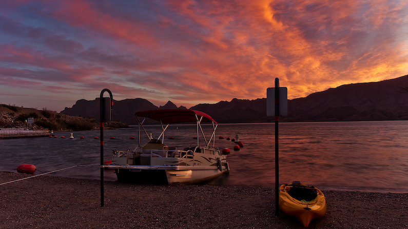 Boats on share of Cattail Cove State Park in Arizona at sunset