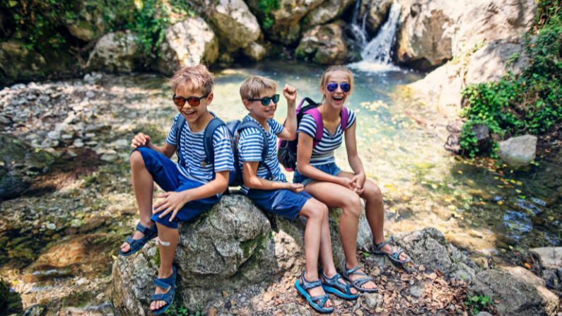 kids hanging out by a waterfall