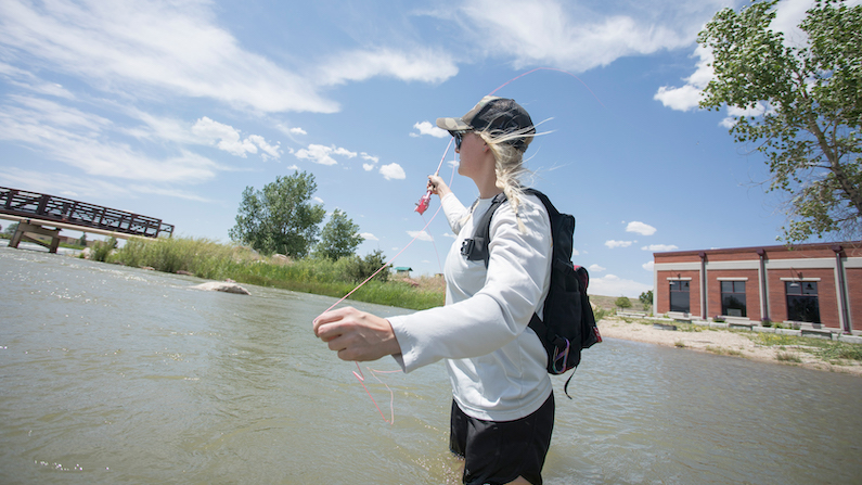 Woman fishing North Platte River in Casper Wyoming
